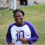 Destiny Sewell smiles at the camera.